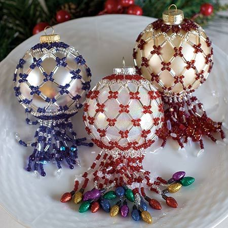 How elegant. Make them for your Christmas tree, or better yet, make them for family and friends. Beaded ornament covers make great gifts for teachers and hostesses during the Christmas season.  Designed by Diane Mugford 604.820.7932 tygarth@shaw.ca