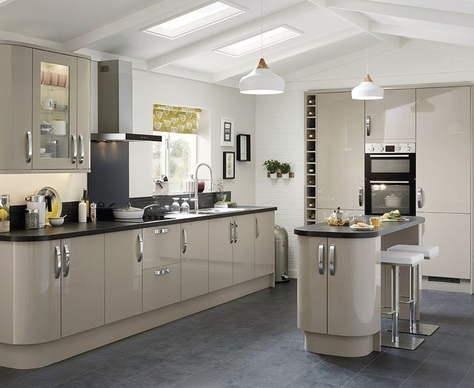 the glendevon gloss stone kitchen features a high gloss stone slab door with a range of matching curved units and accessories to create a highly - Stone Slab Kitchen Decor