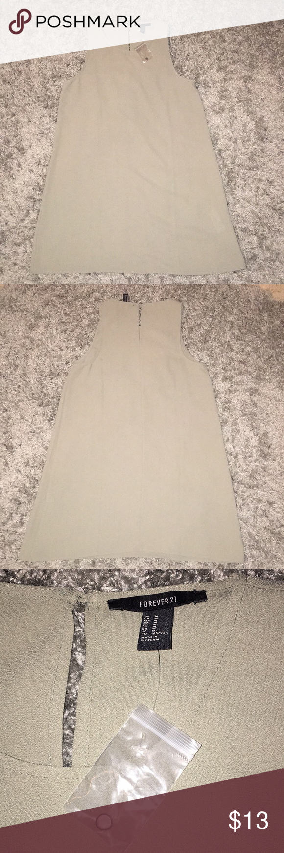 NWT Forever 21 Sage Green A-Line Dress Size M Basically NWT, never worn, except the tag is missing? But I have the button part of the tag? Strange. This is a very elegant sage green dress in an a-line shape. Mini/short length but still modest and covers your booty. Keyhole back with pewter button. 100% polyester. Would look great with a long necklace or a thin belt, or wear it in plain! I bought the dress in three different shades, and decided to keep the black one. Forever 21 Dresses Mini #sagegreendress