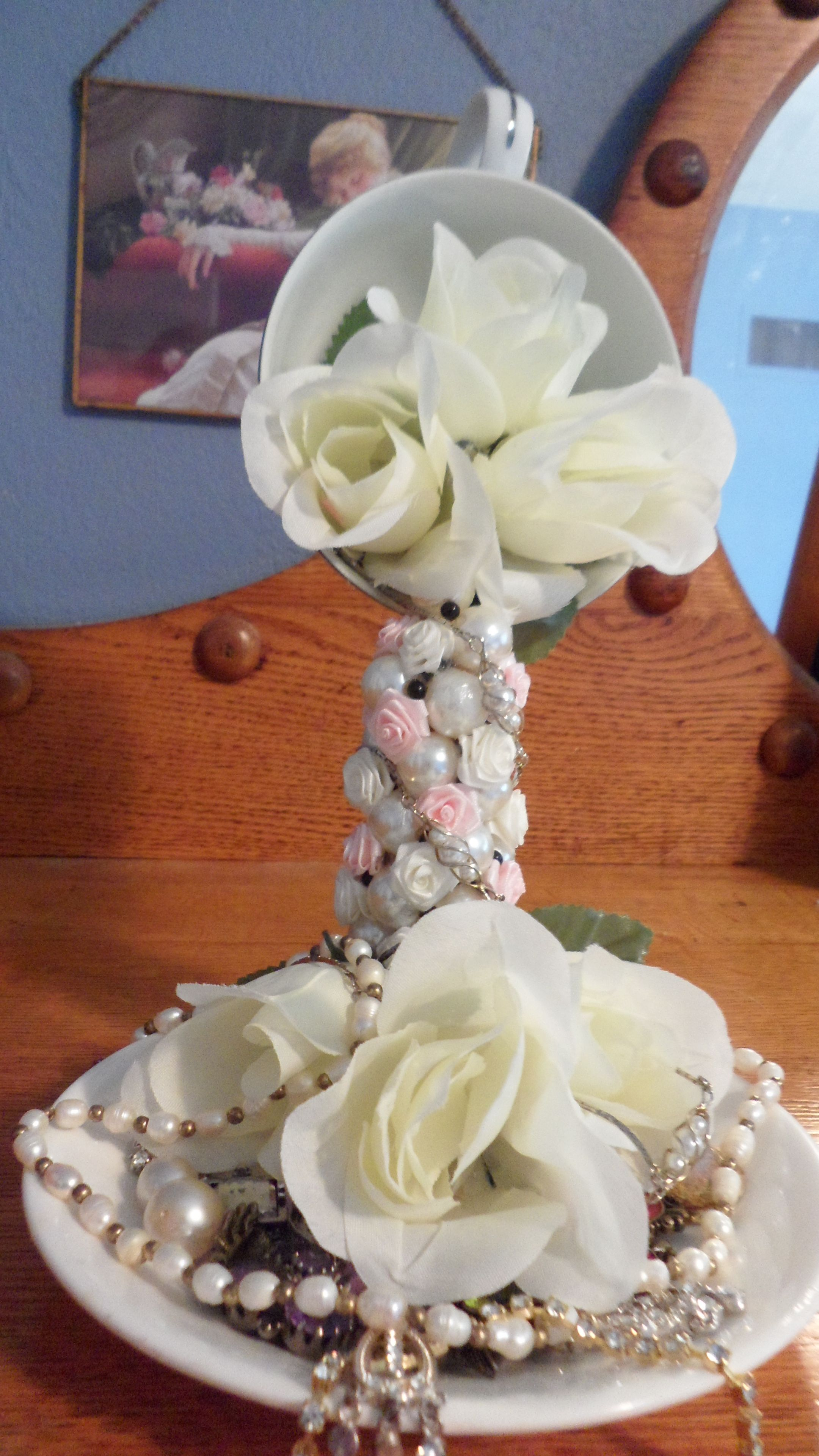 my version of vintage shabby chic floating tea cup. Loads of pearls and gems