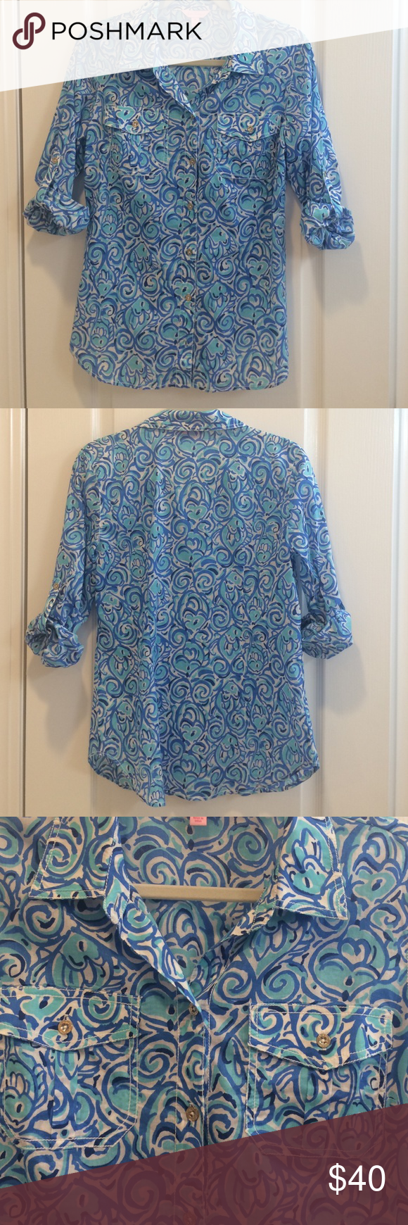 Lilly Pulitzer Top. Blue fish design. Two buttoned pockets in front. Sleeves can be worn up or down. EUC. Only worn a couple of times. 100% cotton. Machine wash. Lilly Pulitzer Tops