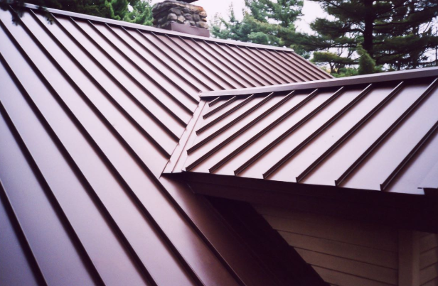 The Cost Of A Metal Roof Vs The Cost Of Shingles Standing Seam Metal Roof Aluminum Roof Metal Roof Houses