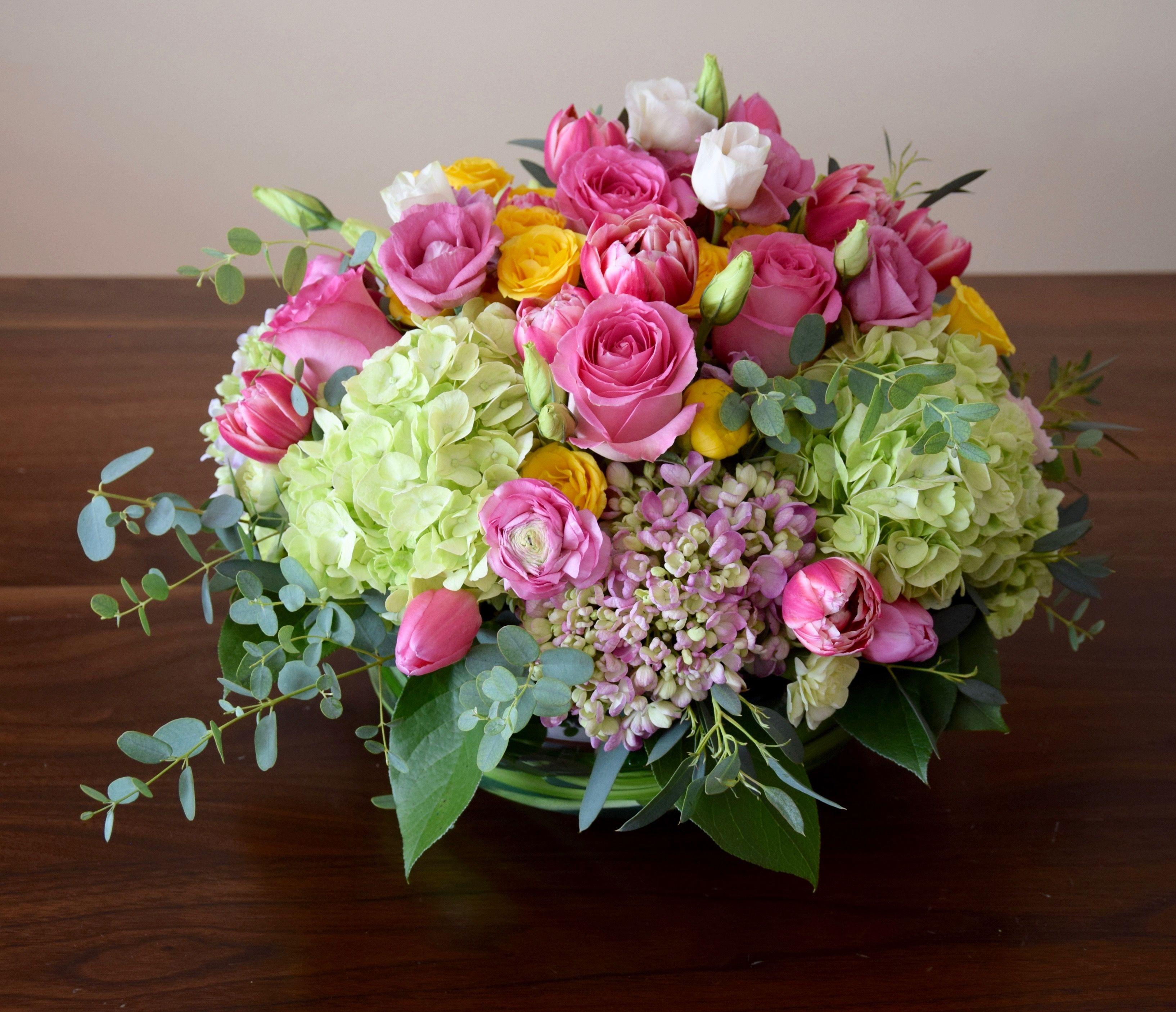 Birthday flower arrangement with pinks yellows greens