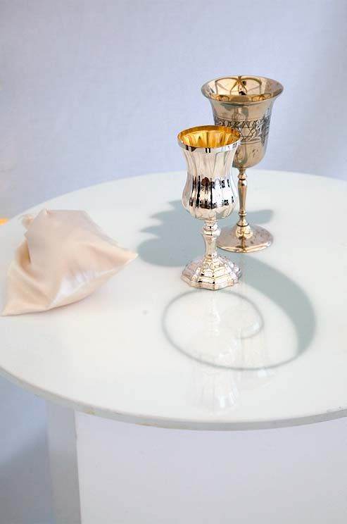 Two Silver Kiddush Cups And A Gl Wred In Silk Await The Rituals Of This Jewish