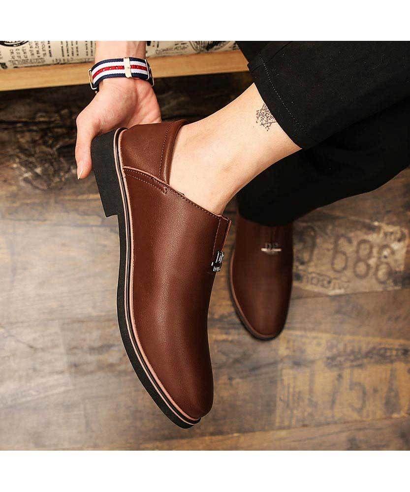 Brown metal label slip on dress shoe