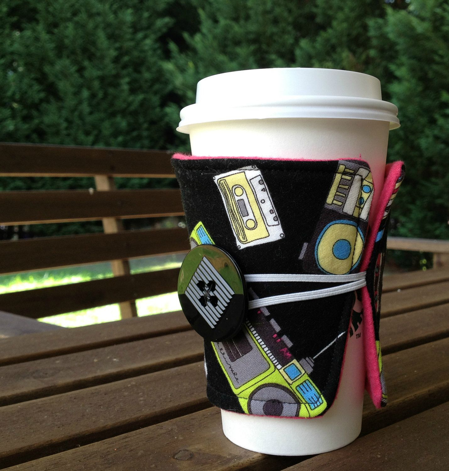 Drink Coffee.  Be Green.  Look Rad with the Bugaroo Fabric Coffee Cozy - Retro Boomboxes with Hot Pink Flannel Lining. $6.50, via Etsy.