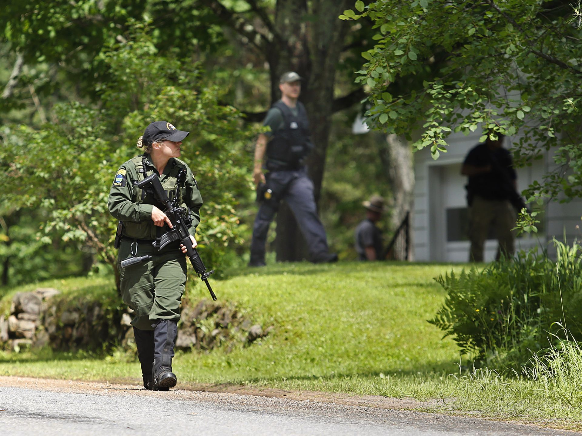 A New York State Department of Environmental Conservation officer walks  along Mt. View Avenue in