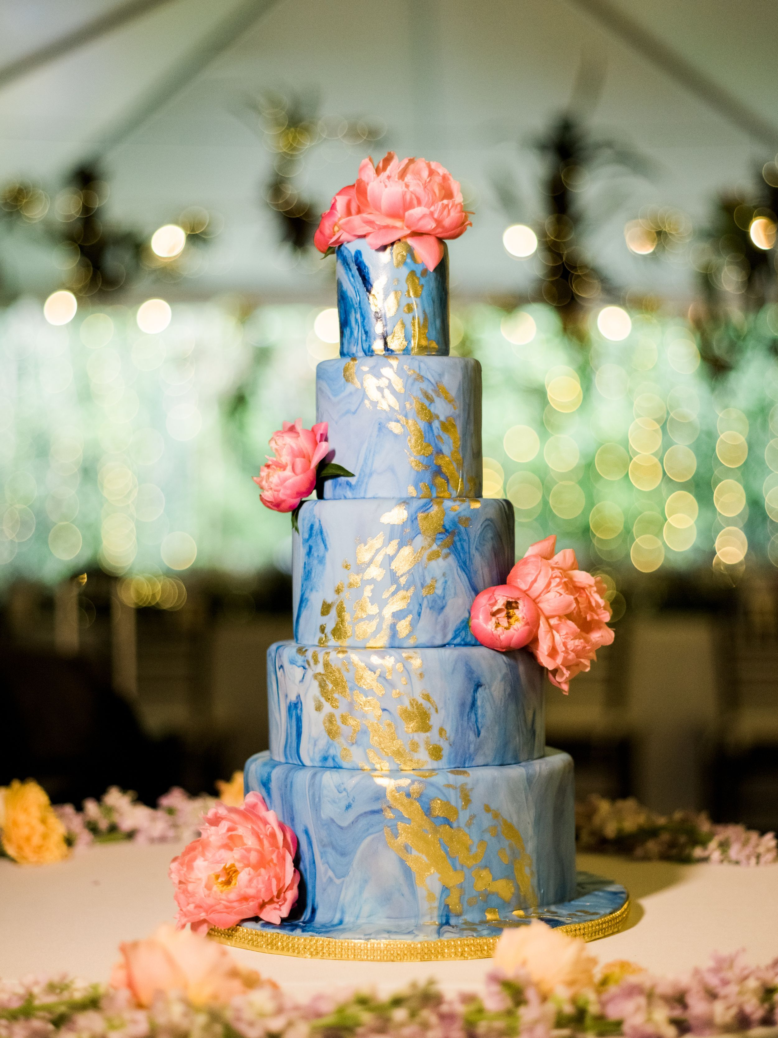 Blue and white marble fondant cake with gold accents with