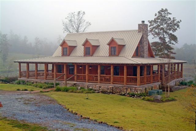 Log cabin with a tin roof and a wrap around porch for House plans with porch all the way around