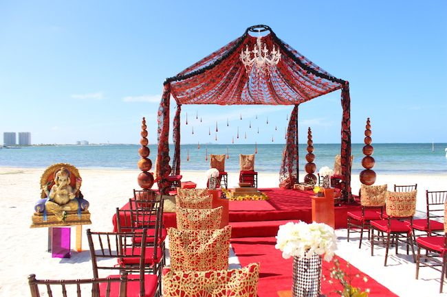 Red mandap for Hindu wedding ceremony on beach in Mexico ...