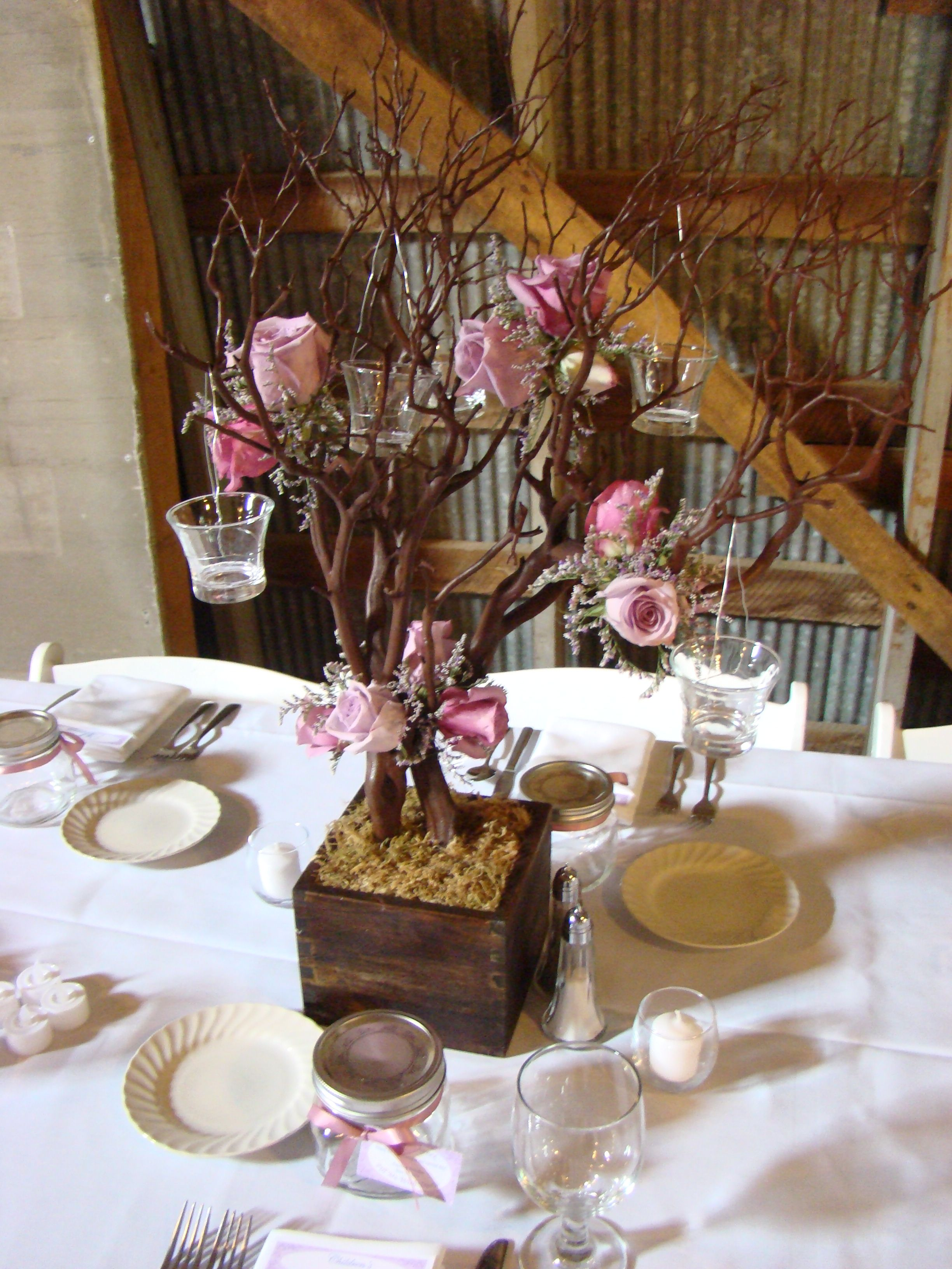 Manzanita tree centerpiece with lavendar roses and mini