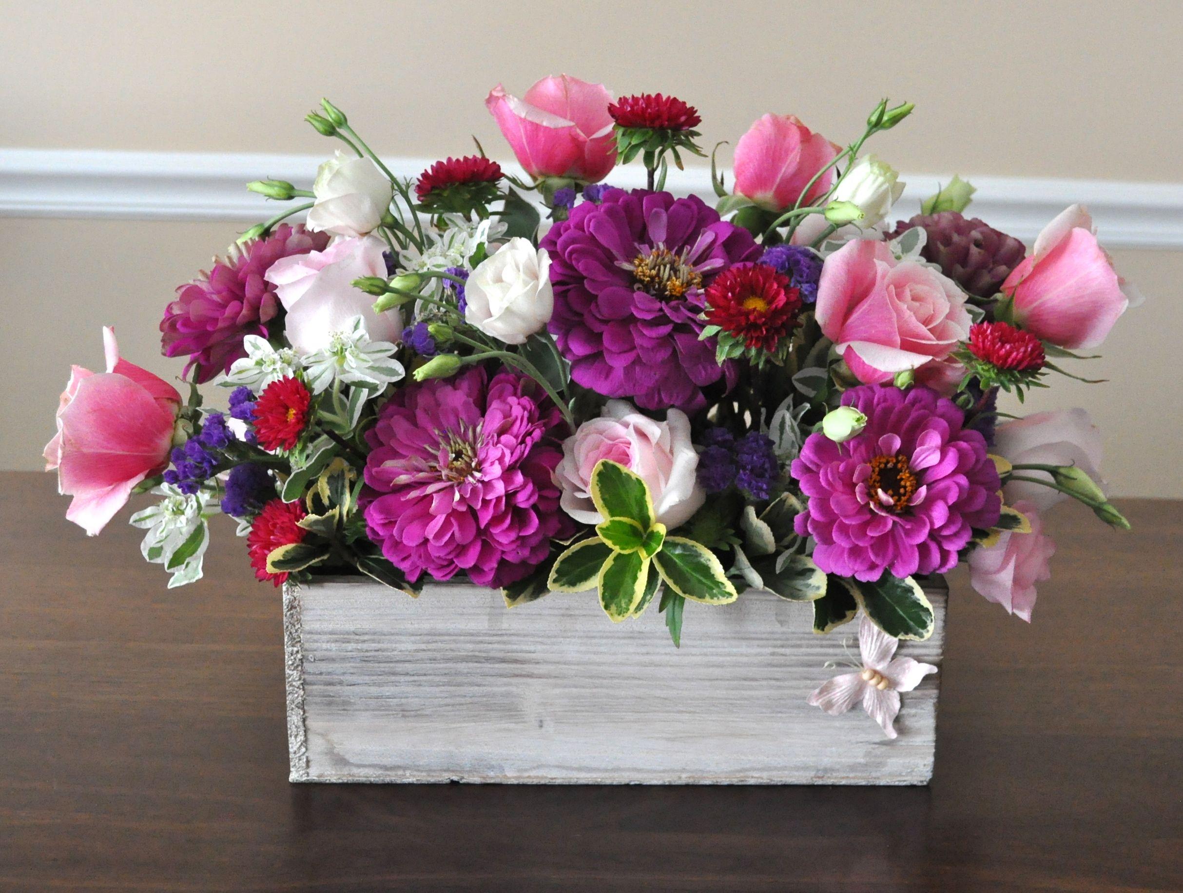Postwedding celebration centerpiece. Fresh flowers