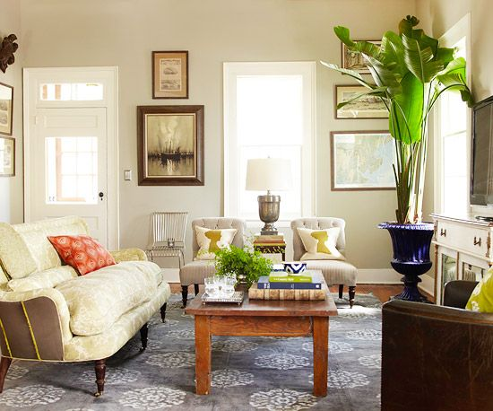 Create a vintage-inspired living room with silhouette pillows and repurposed furniture. More living room design ideas: http://www.bhg.com/rooms/living-room/makeovers/living-room-decorating-ideas/#page=22