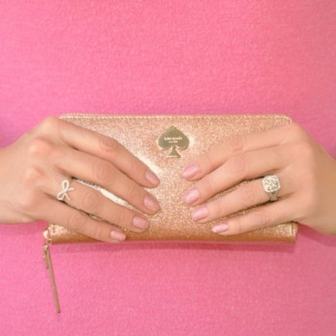 Rose gold glittery Kate Spade wallet and Sephora nail polish. I'm obsessed with this color! Confession on the blog TwirlySkirt.com #sparkle #glitter #rosegold #mani #manicure #nails #nailpolish #pink #beauty #beautyguru #beautyblogger