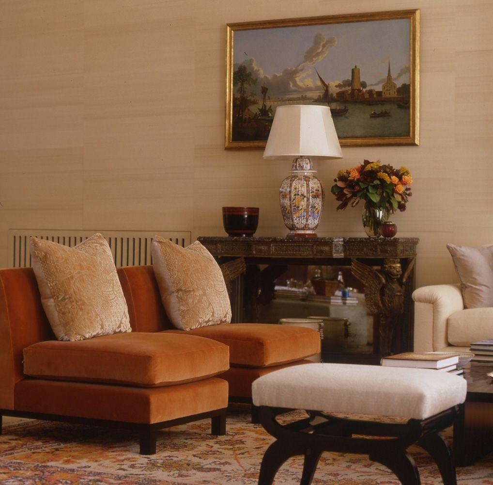 Living room with burnt orange velvet chairs