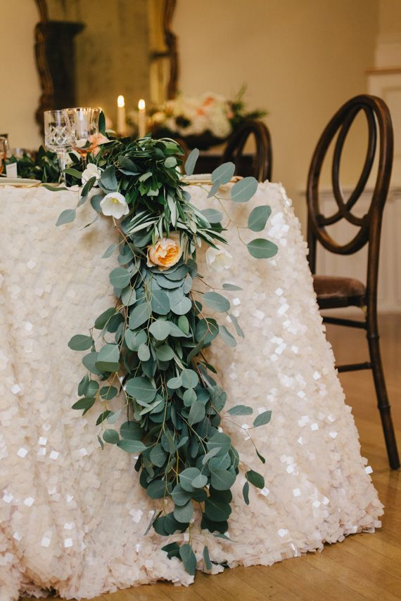 U201cUsing Eucalyptus As A Table Runner Is One Of Our Favorite Table Trends.  Also, Hello Sparkly Table Linen!