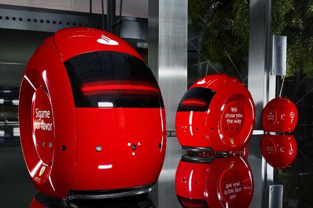 The Sleek Crimson Droids Dubbed Santander Interactive Guest Assistants