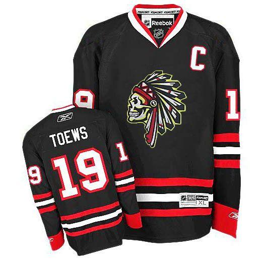 Blackhawks Jonathan Toews Reebok Premier Black Skull Ice Hockey Jersey 53b5fed2fbb