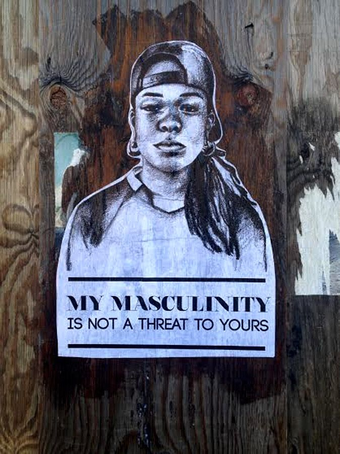 """""""My masculinity is not a threat to yours""""  [follow this link to find a documentary exploring the lives of lesbian women who prefer to dress and act as men and who participate in NYC's predominantly African-American lesbian drag balls: http://www.thesociologicalcinema.com/videos/the-aggressives]  Artist: Tatyana Fazlalizadeh"""