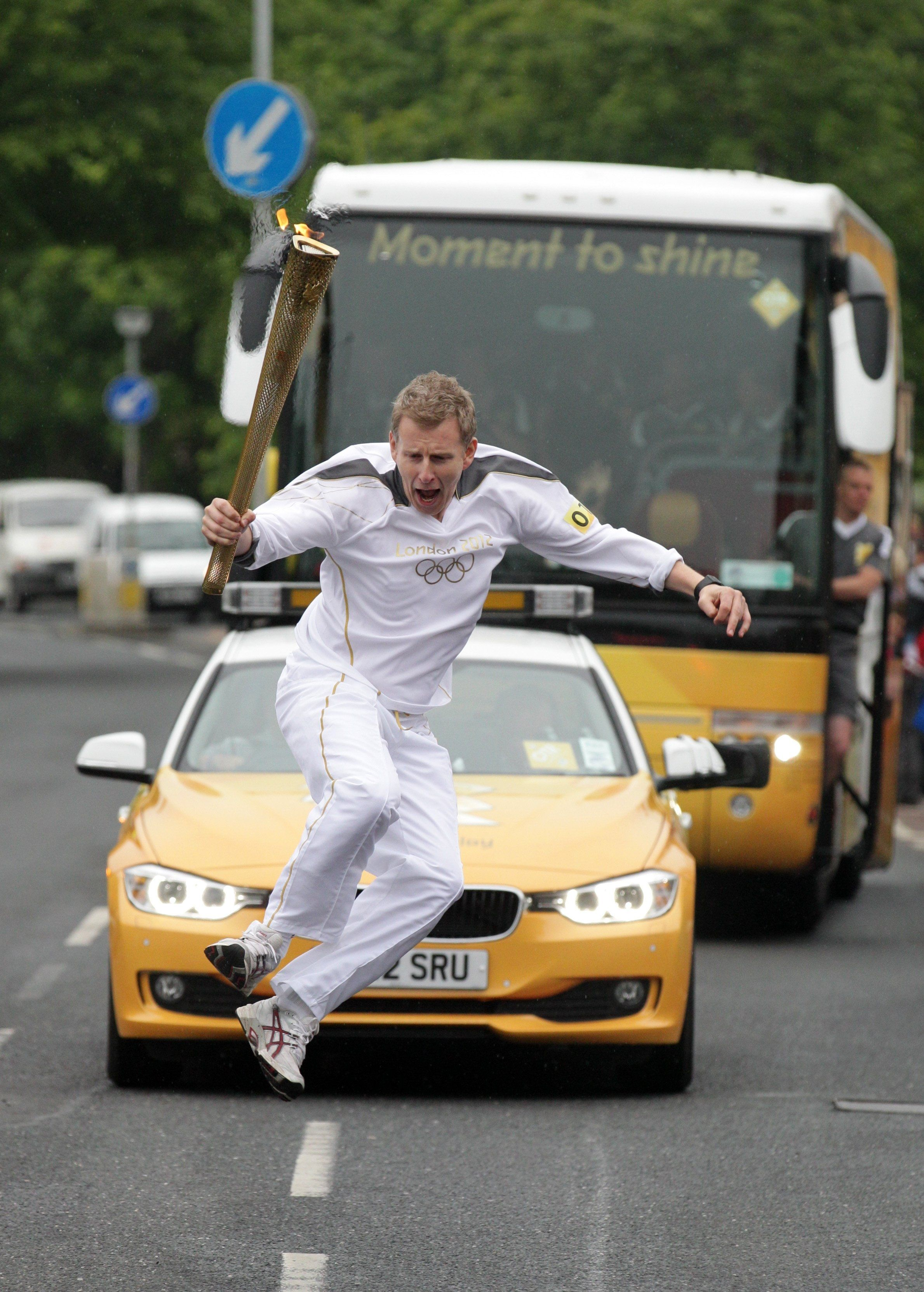 Torchbearer and TV Presenter Patrick Kielty carries the