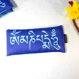 """this eye pillow has """"om mani padme hum"""" printed on the"""