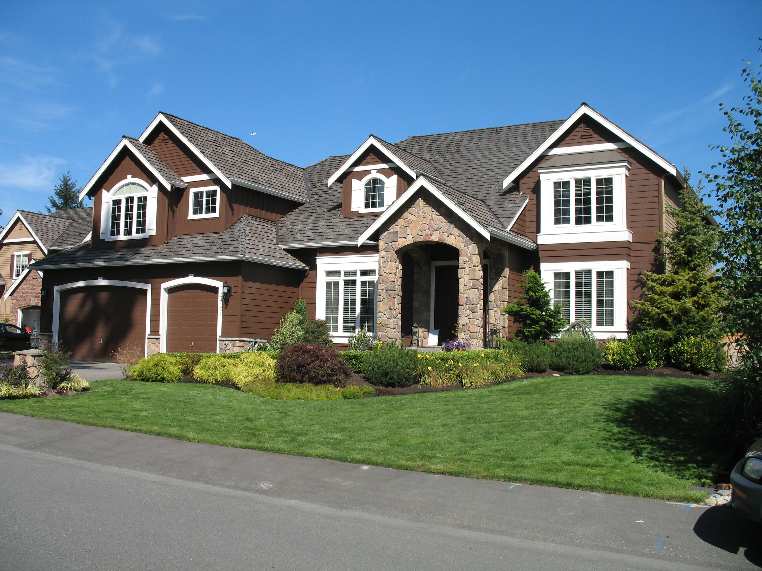 Exterior house color schemes with black shutters - Top 20 Brown Houses With White Trim Light Dark Exterior Ideas