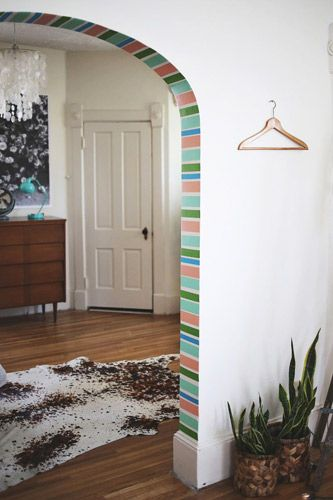 Spruce up an archway in your room by using washi tape. It's inexpensive and comes in many colors and patterns.