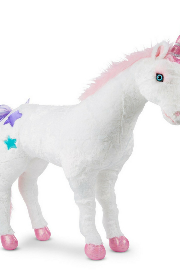 2aa0ef915b3 A giant stuffed unicorn by Melissa and Doug that would look great in a  nursery or beside your bed. This lovely plushie stands over 2 feet!