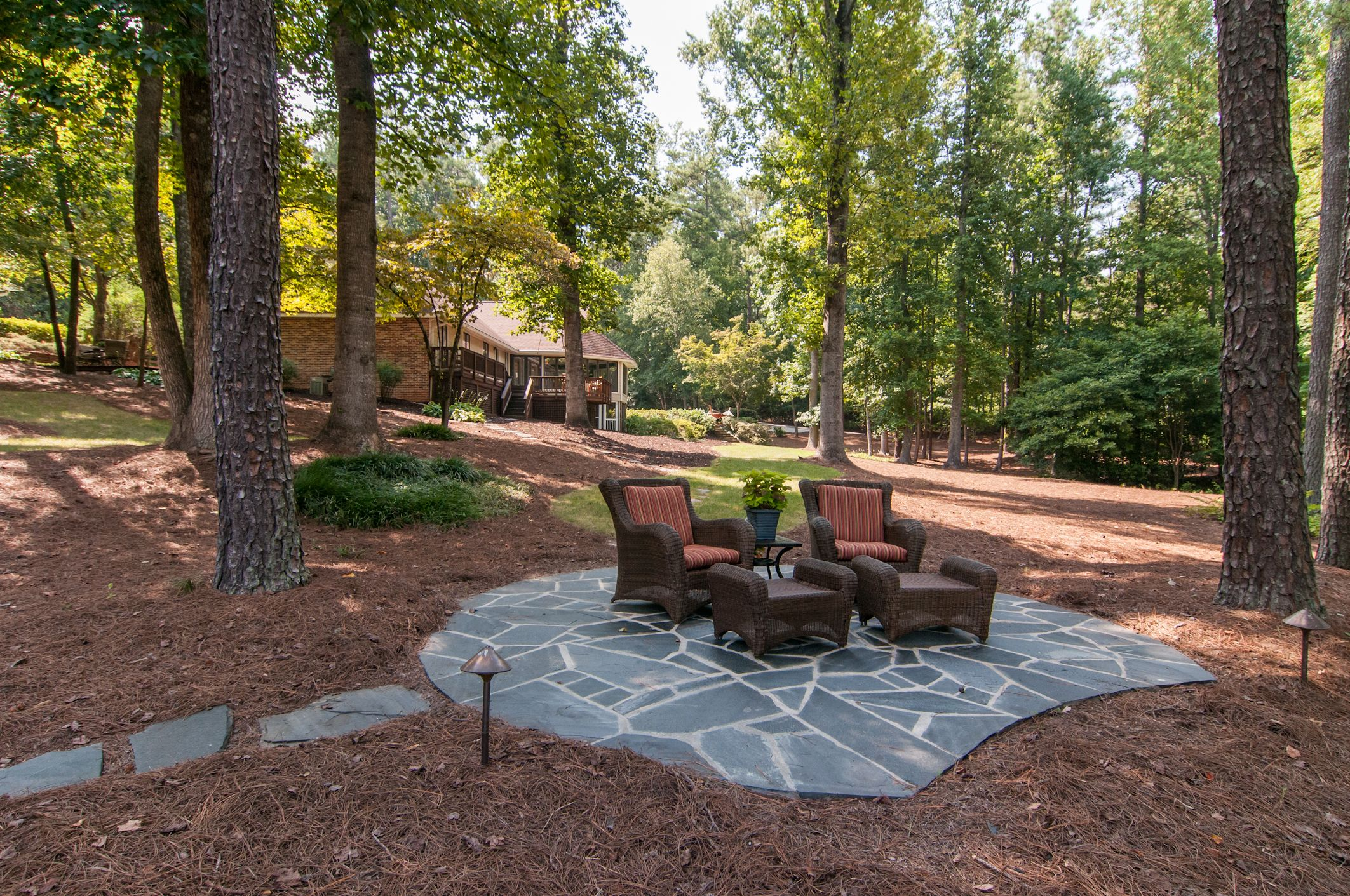 #dunwoody Lakefront Stone Patio. Lush Landscaping with ... on Lakefront Patio Ideas id=43583