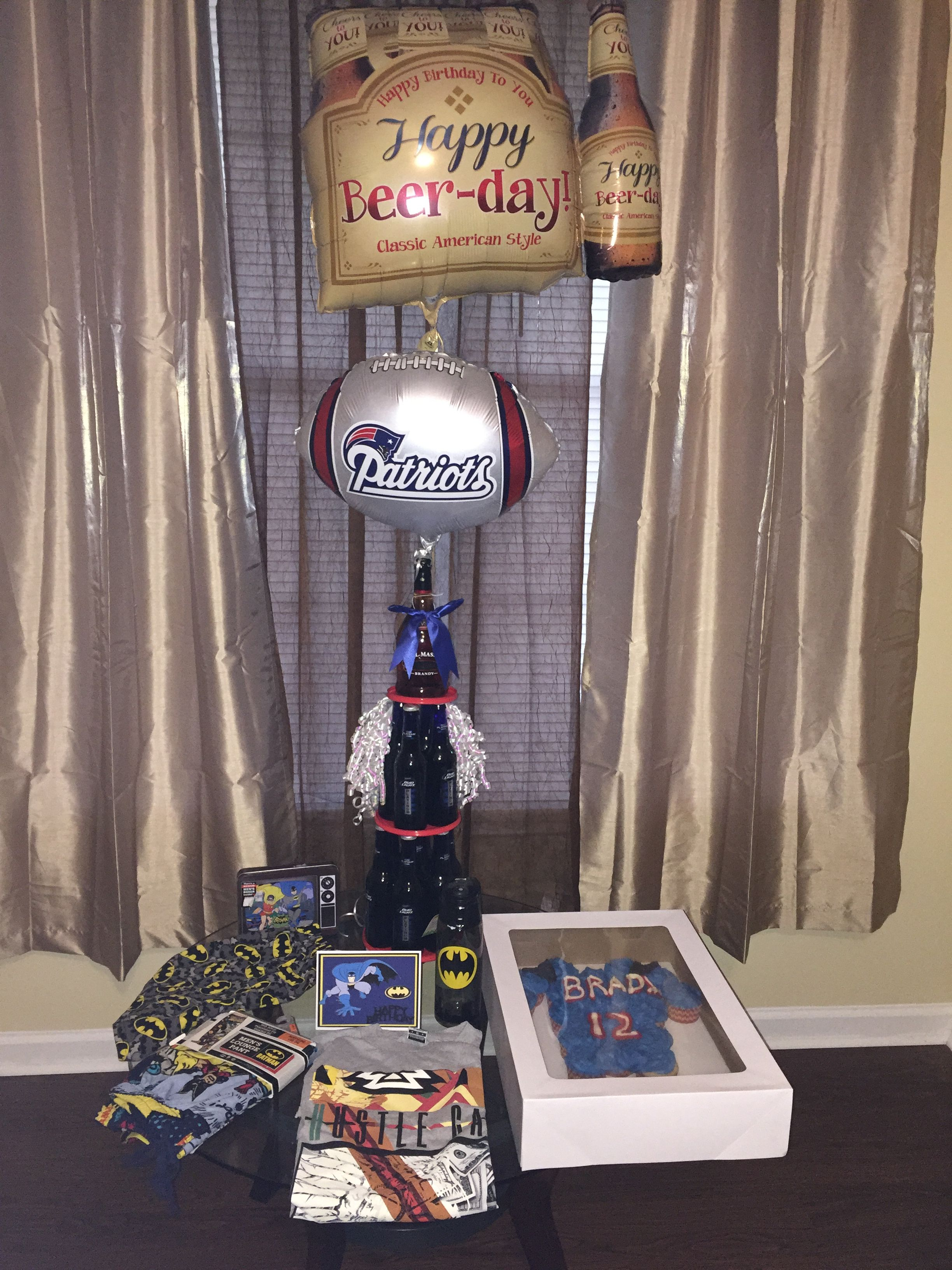 Beer cake I did for my husband with his favorite items #patriots #batman #beercake