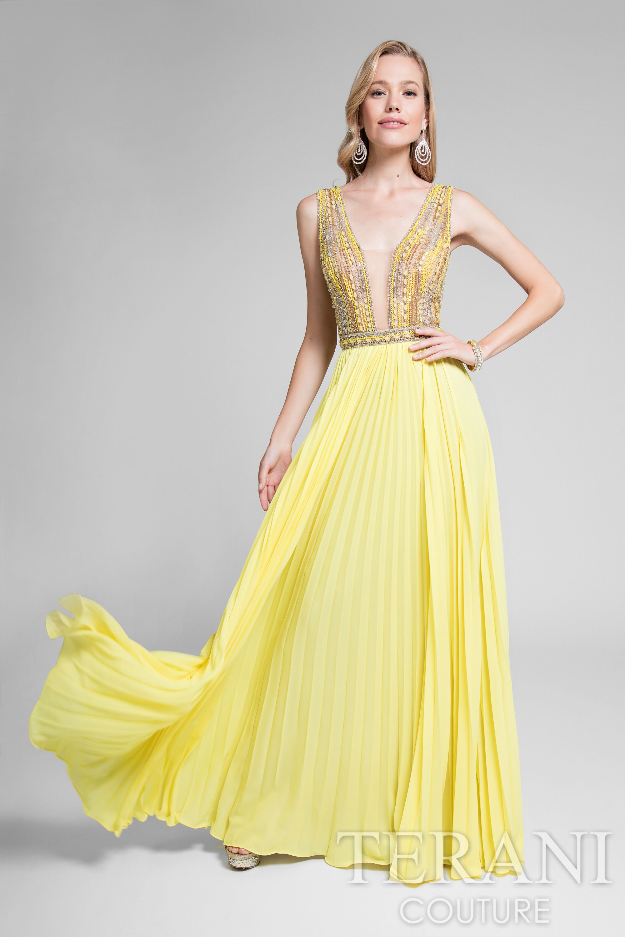 Gorgeous sleveless designer gown with plunging nude illusion