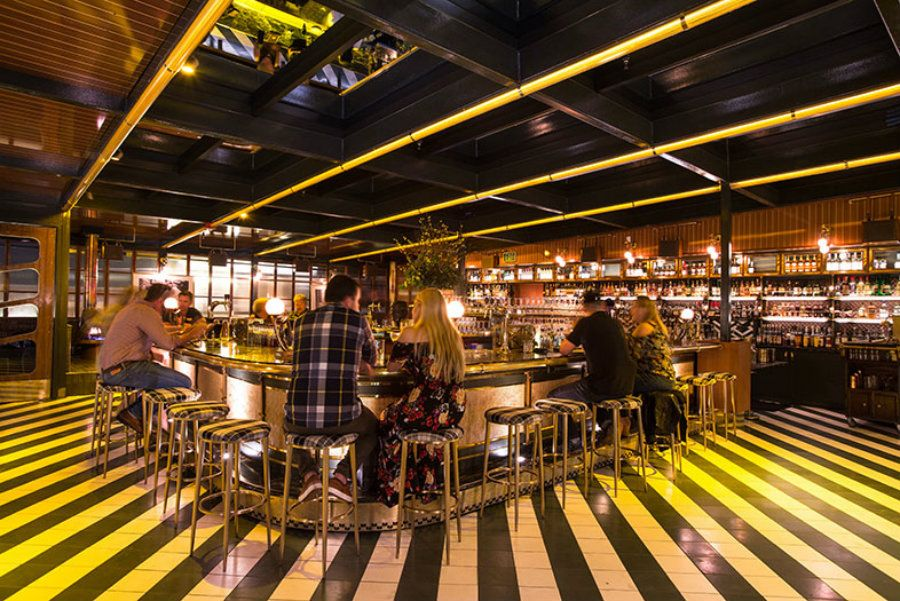 Midcentury Bar Ideas Born And Raised Rooftop Is A Show Stopping Bar Interior Design Restaurant Interior Design Bar Restaurant Interior