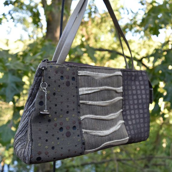 Check out this item in my Etsy shop https://www.etsy.com/listing/250447305/fabric-handbagsmalltaupe-graydecorator