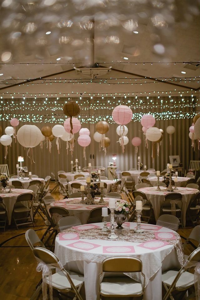 Bringing the ceiling lower via lights balloons etc our for Wedding hall decoration photos