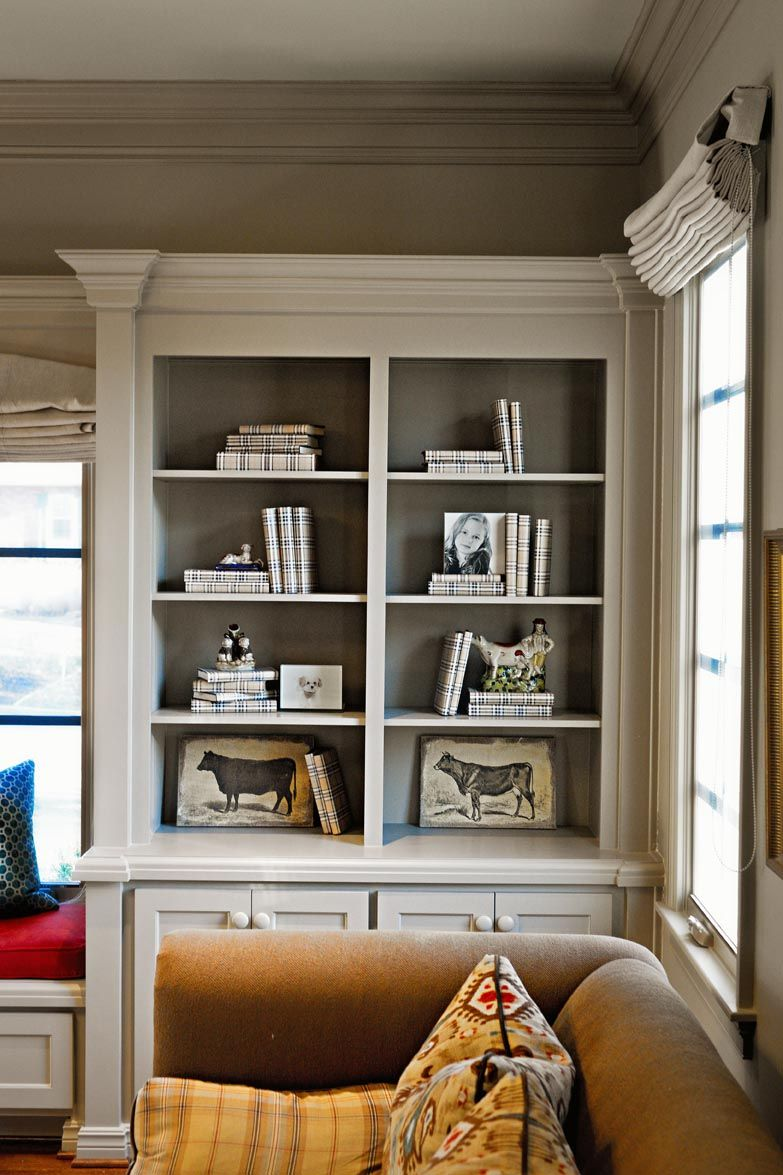 Molding on the bookshelves with contrasting color painted for Bookshelf display ideas