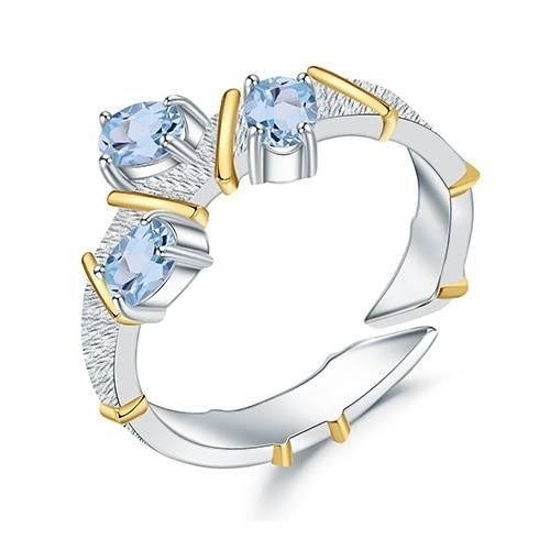 Free Shipping: USA (9-15 days) Description: These rings are the perfect jewelry to take an oath of true love. The delicate light blue topaz makes it very sophisticated and the gold details give it a very elegant style. Its base is made of sterling silver and its surroundings are decorated by small topaz, they are the perfect engagement match and some pieces that you will fall in love with. Care and Maintenance: Store your jewelry in the original packaging or in a soft case to avoid scratches. Av