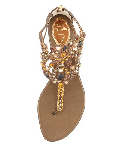 """Rene Caovilla  Crystal Caged Crown Thong Sandal, Bronze  In the heat of Summer, trade your usual heels for these Rene Caovilla thong sandals. The lavishly embellished vamp and golden heel keep you comfortable yet appropriately dressed for outdoor cocktail parites. Crystal-embellished metallic leather. Embellished front band forms caged vamp. Thong strap connects to high-cut vamp. Back zip for ease of dress. 1/2"""" metallic wedge heel. Leather lining and sole. Made in Italy."""