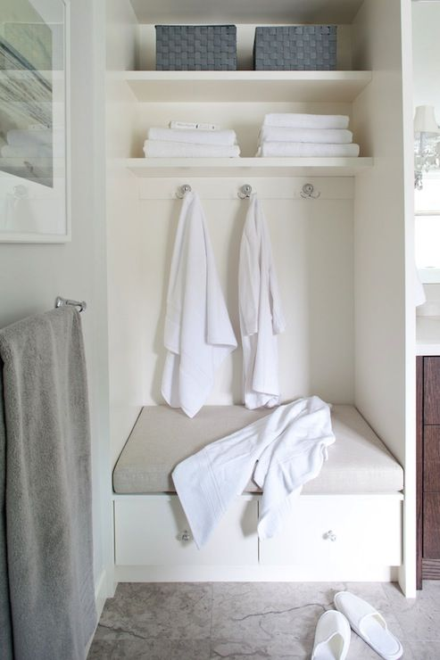 Across From The Steam Shower Is A Cabinetry Tower With Bench Seat Two Drawers And Open Storage Overhead For Fresh Linens