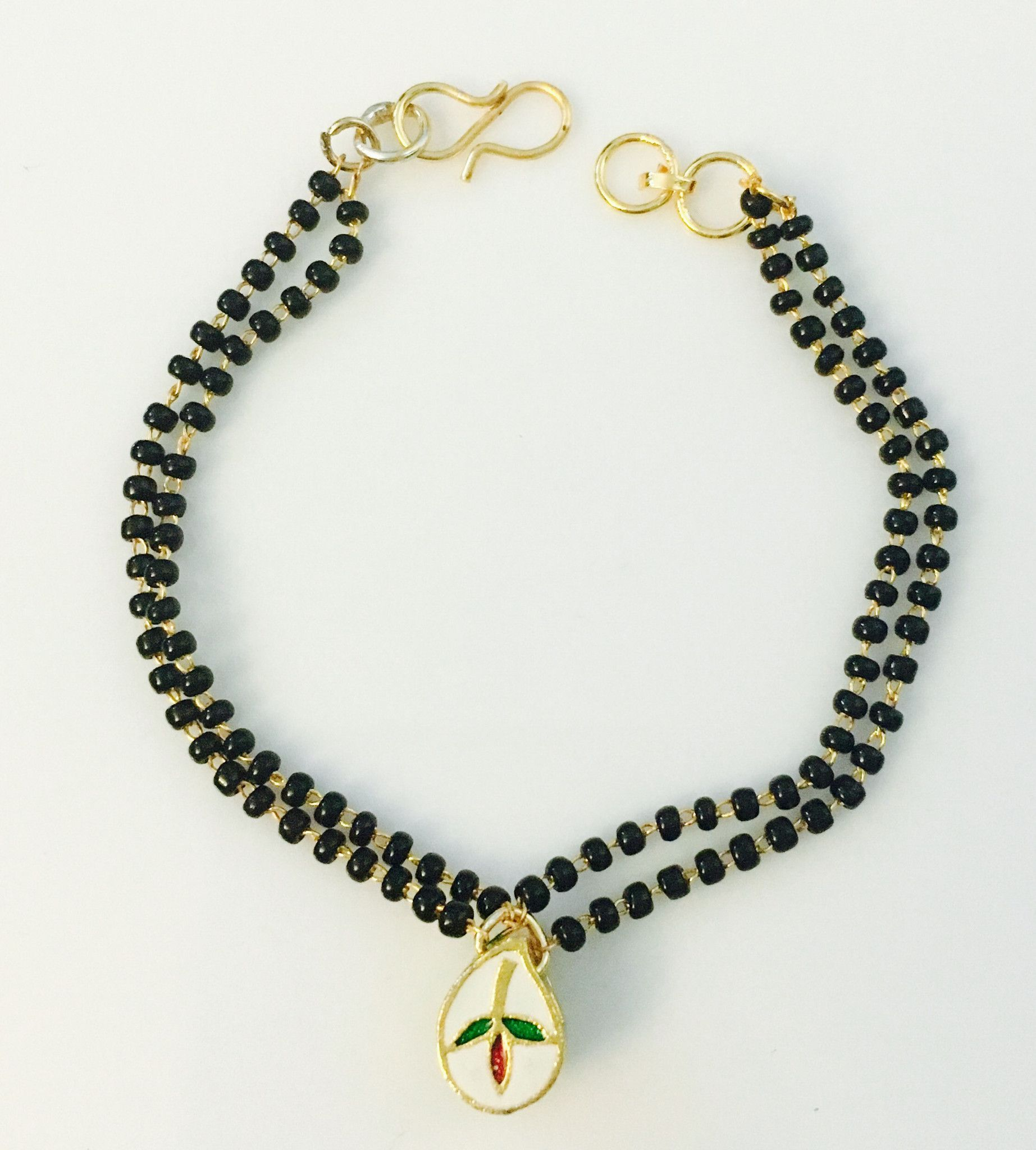 bd6a11045eaa24 modern yet traditional mangalsutra bracelets made famous by shilpa shetty.  can fit sizes 2.4 to 2.8