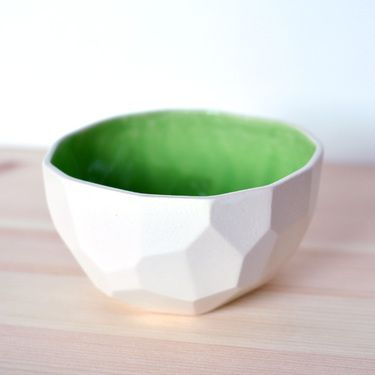 faceted polygonal bowl, something that Buckminster Fuller might have eaten his cornflakes out of.