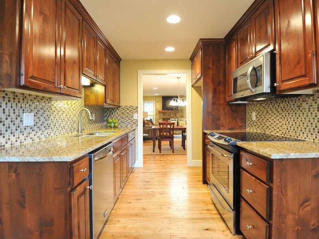 Dark cabinets, tiled backsplash in small galley kitchen | Kitchen ...