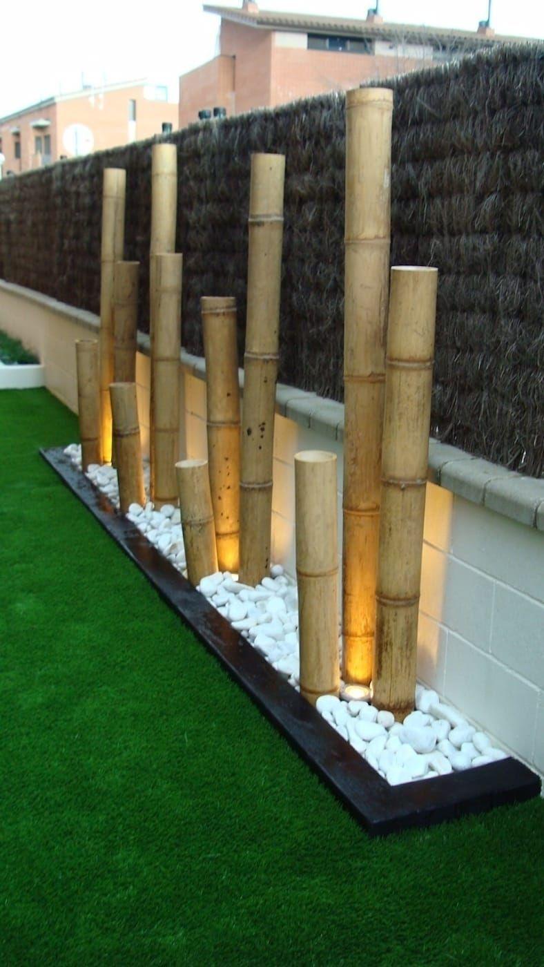 Jardinera con bambú y bolo blanco con iluminación: terrazas de estilo de dbambu, moderno