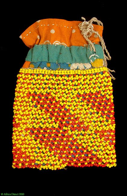 San Beaded Pouch/Powder Puff Bag Botswana, Africa  Type of Object: Beaded Pouch or Powder Puff Bag  Ethnic Group: San also known as Bushmen  Country of Origin: Botswana  Materials: beads, cotton cloth  Approximate Age: 1960s-1970s