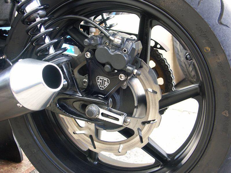 triumph twin power rear caliper relocation bracket | bike part