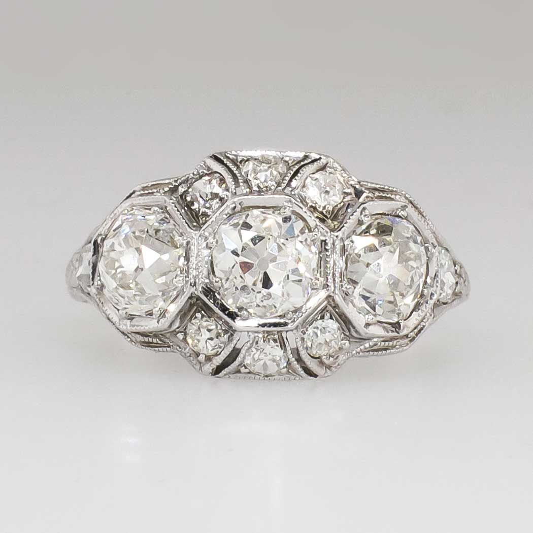 Breathtaking 2.49ct t.w. Edwardian Old European Cut Diamond Engagement Ring 18k | Antique & Estate Jewelry | Jewelry Finds Price: $8500.00  This is the kind of ring I'm talking about!!! Amazing detail work, glittering chunky old European cut diamonds, clean crisp hand engraving, and a low profile. Wear this as an engagement, anniversary, or right hand ring! Don't miss out as these Edwardian beauties