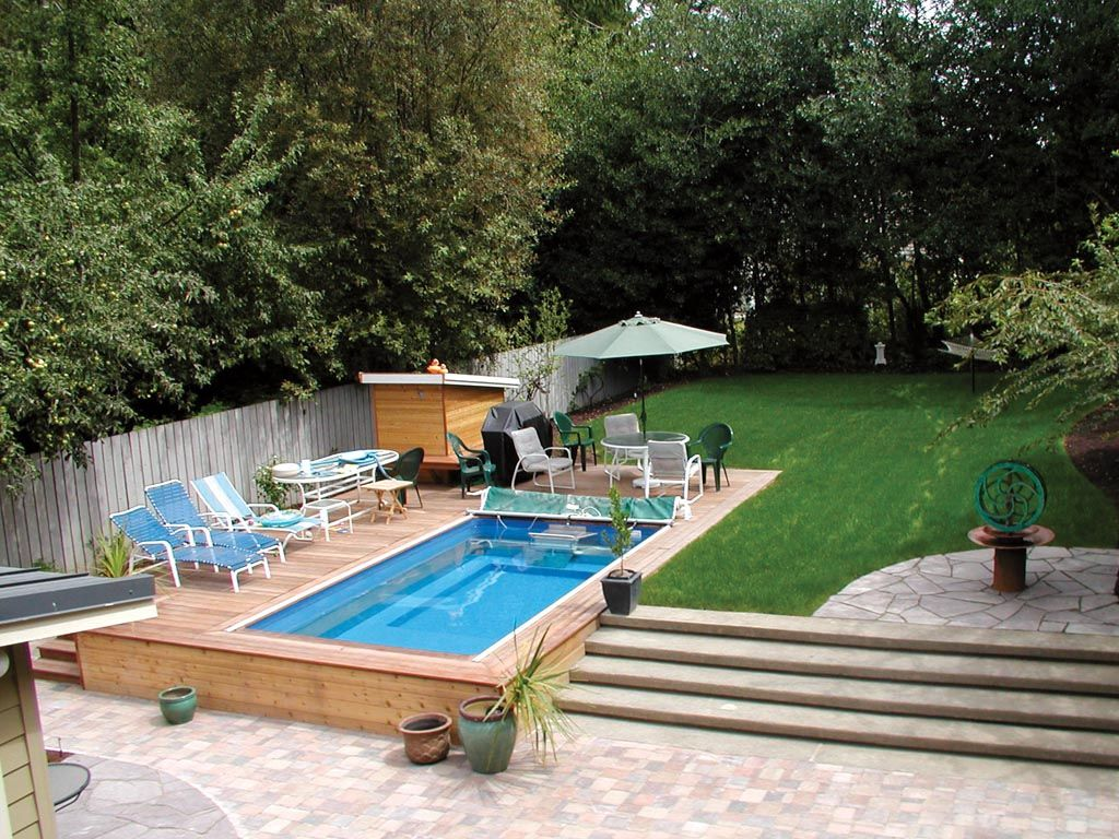 An endless pool is a great addition to any backyard swim for Pictures of swimming pools in backyards