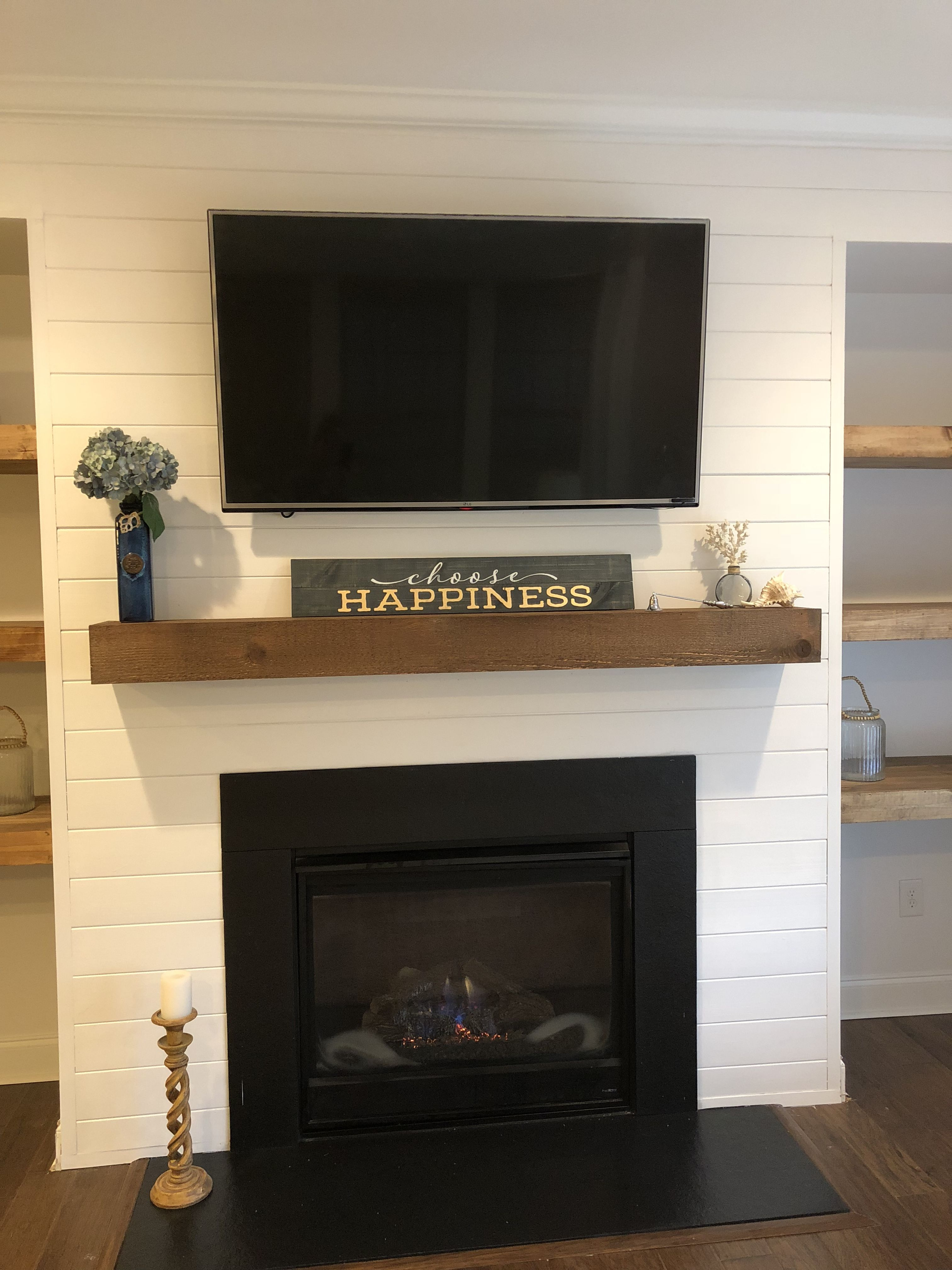 Shiplap and new mantle around fireplace. Home fireplace