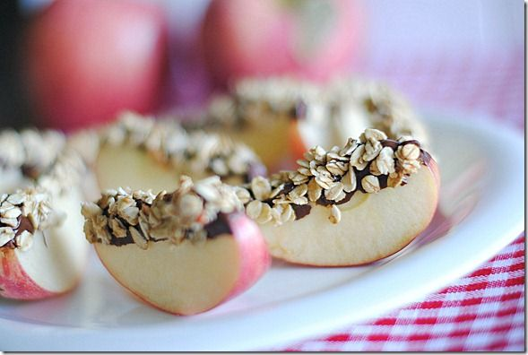 A nice simple snack. Apples + Nutella + Granola