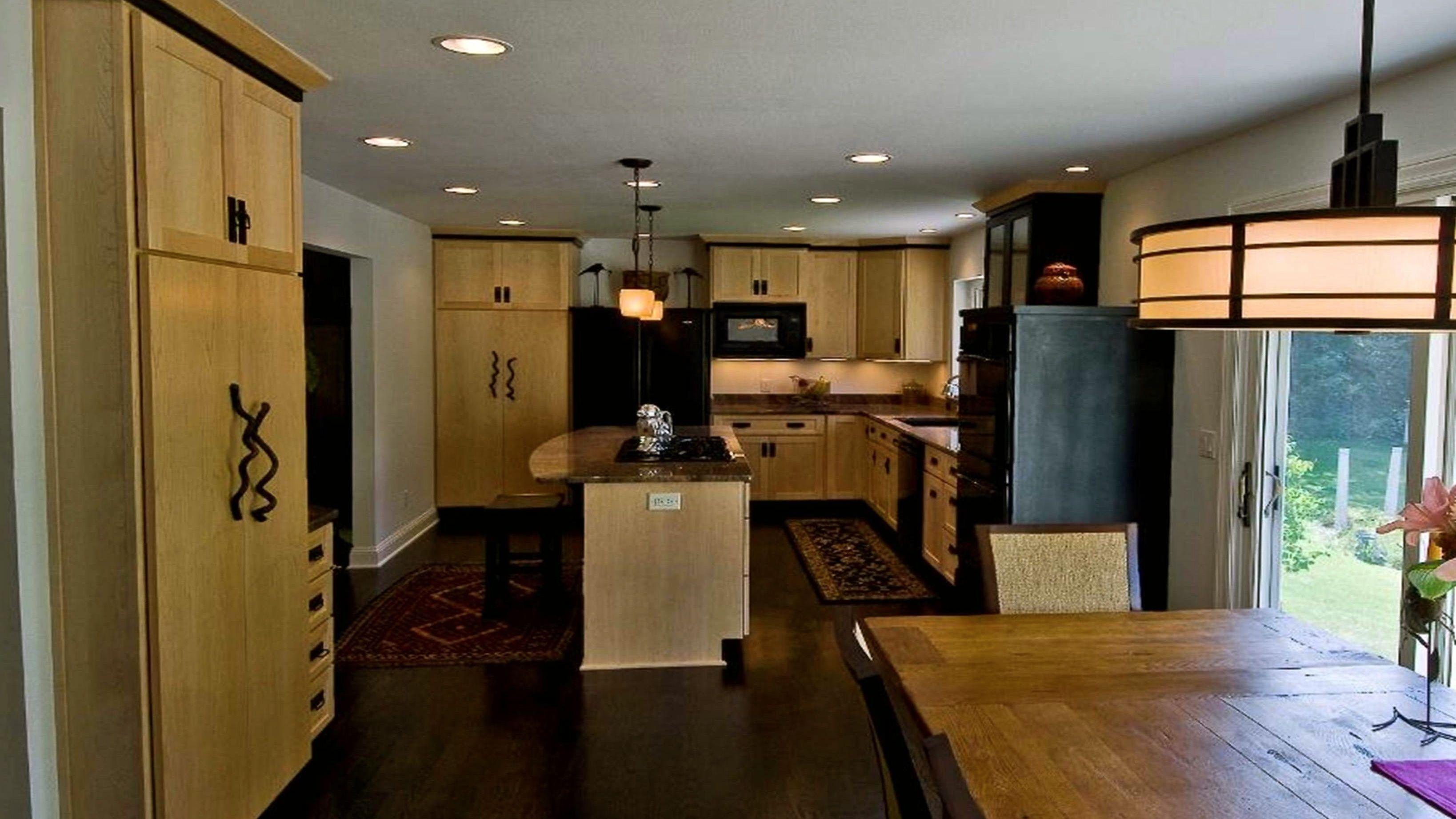 Walnut floors, maple cabinets, dark countertops, soft yellow walls ...