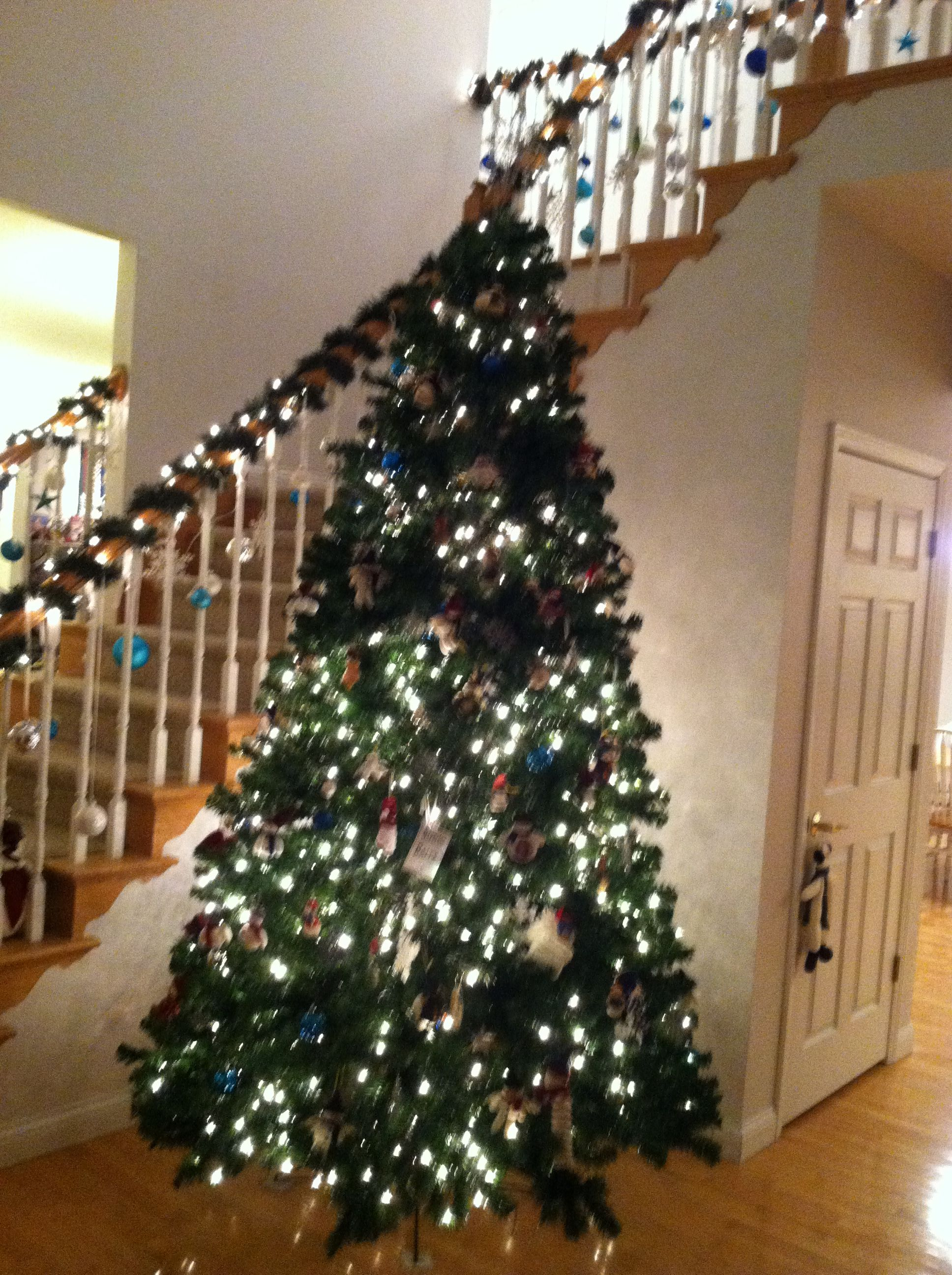 Cute Christmas tree theme ...snowmen! An love the ornaments hanging from railing.